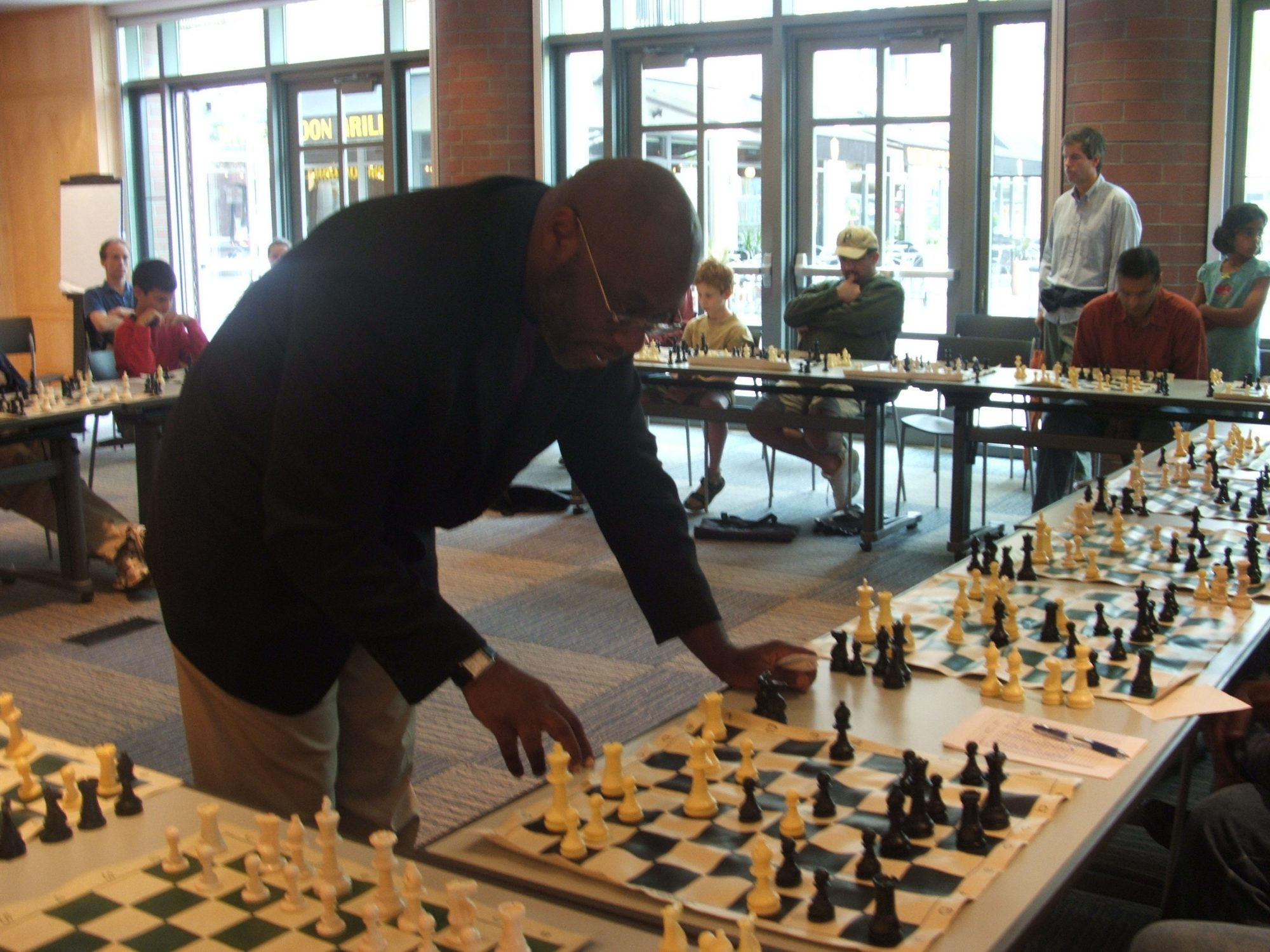 Life Master Glenn Bady give chess lessons