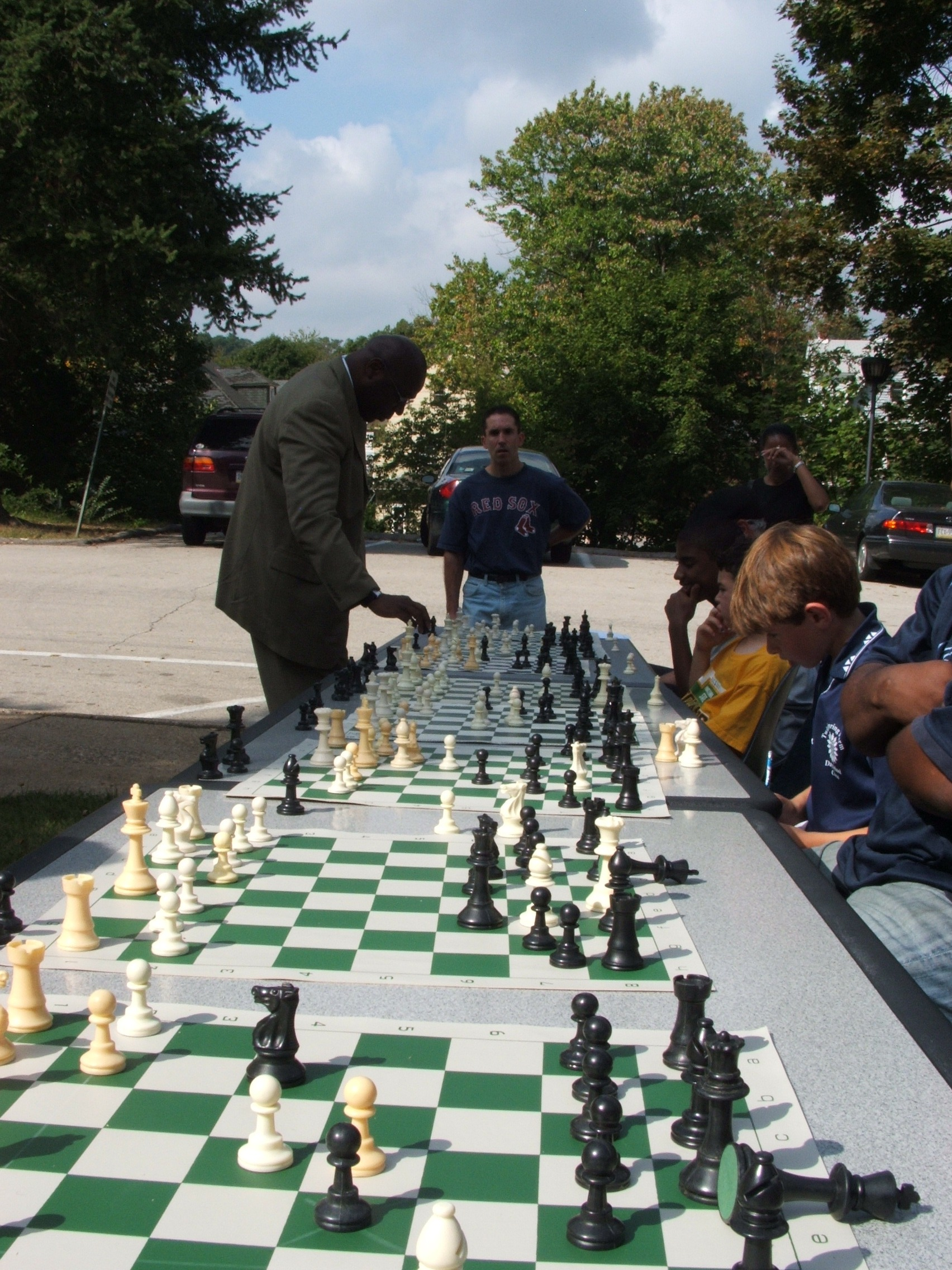 Glenn Bady takes on 20 chess players simultaneously at Glenside, Pa summer camp