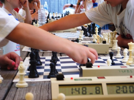 Kids summer chess camp. Campers learn how to play and beat their dad.