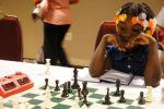 girl kid playing chess